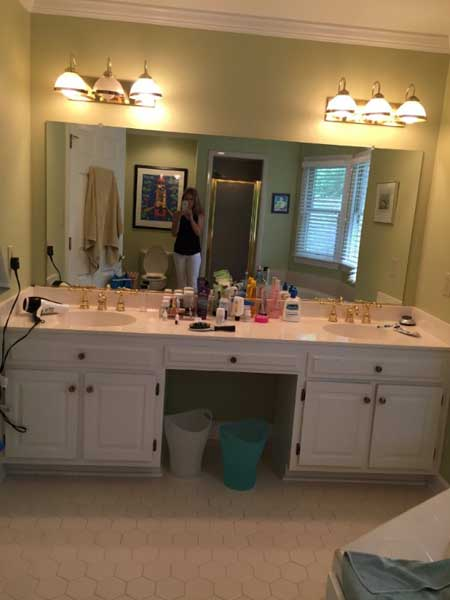 Bathroom with white cabinets before remodel