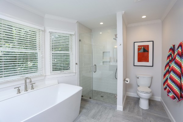 Large white soaking tub after remodel