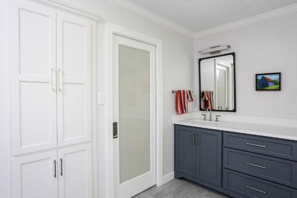 Dark grey bathroom cabinets after bath remodel