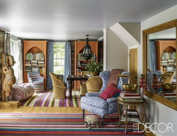 Family room with blue check curtains and a blue patterned chair pictured in Elle Decor