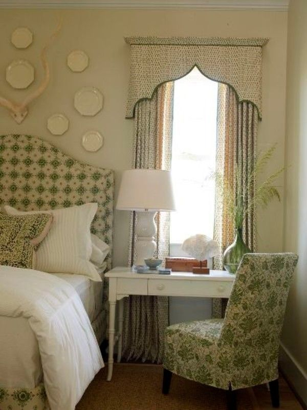 Custom draperies in a decorated bedroom