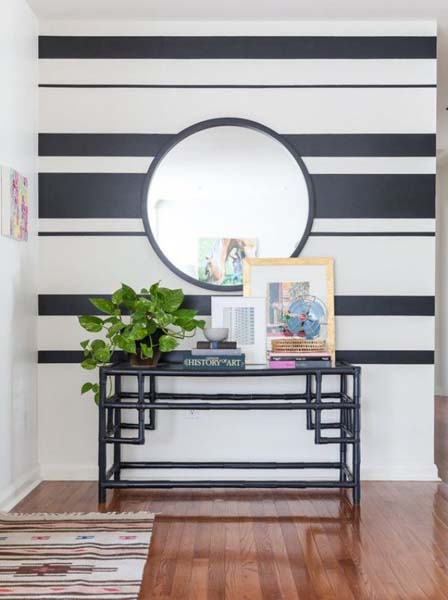 Foyer with black and white stripped wallpaper